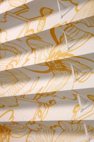 Detail látky a úpravy plisé
